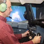 Professor Peter Grant (UTIAS) practices responding to an aerodynamic stall in a flight simulator at the University of Toronto Institute for Aerospace Studies. (Credit: Marit Mitchell).