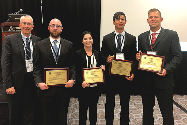 Left to right: Professor Steven Thorpe (MSE), Bryan James (MSE 1T6 + PEY), Jessica MacInnis (MSE MEng candidate), Matthew Chen (MSE MASc candidate) and Yuri Savguira (MSE PhD candidate). This team took first place at the international 2017–2018 Hydrogen Student Design Contest for Motion+, their plan for a hydrogen-powered luxury boat.