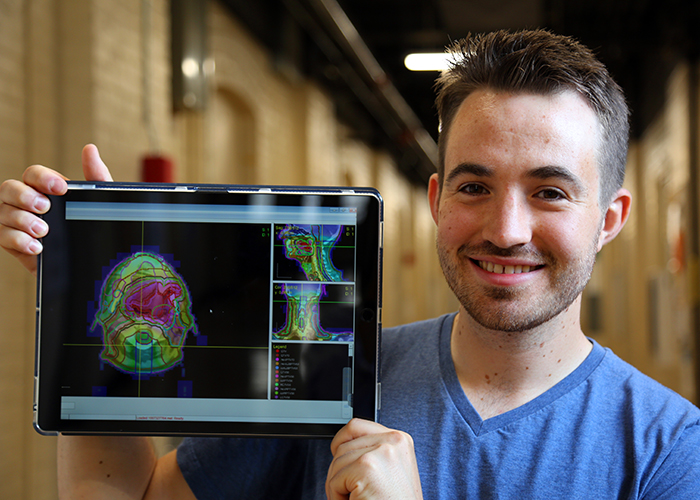 Aaron Babier (MIE PhD candidate) demonstrates his AI-based software's visualization capabilities. (Credit: Brian Tran)