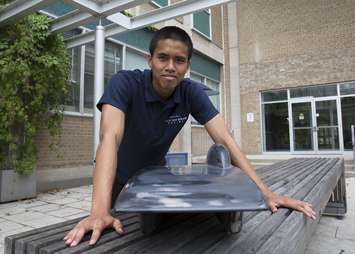 Blue Sky Solar Racing's aerodynamic lead, Khanin Thongmongkol (Year 4 EngSci) with a 3D model of Polaris. The team conducted wind-tunnel tests of 3D-printed models of two retired vehicle designs, Horizon and Polaris, to help inform the design of their 10th generation vehicle. (Credit: Liz Do)