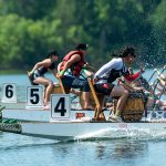 Two Iron Dragons crews, boats #4 and #6, race in the University Division finals at a regatta on Toronto Island in June 2018. Boat #4 placed first, and boat #6 placed third. This summer the national champions are flying to Szeged, Hungary to compete at the dragon boating world championships. (Credit: Laura Pedersen)