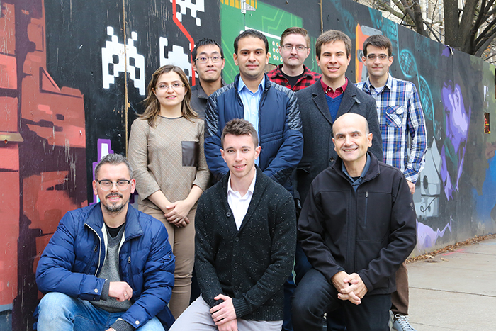 Professor Moshovos and his team. Front row, left to right: Zissis Poulos, Dylan Malone Stuart, Professor Andreas Moshovos; back row, left to right: Sayeh Sharifymoghaddam, Kevin Siu, Mostafa Mahmoud, Patrick Judd, Alberto Delmas Lascorz, Milos Nikolic. (Credit: Tyler Irving)