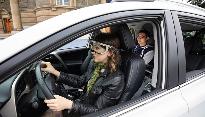 Nazli Kaya (MIE MASc candidate) wears the eye-tracking device used to accurately assess where drivers were looking when turning at intersections. (Credit: Laura Pedersen)