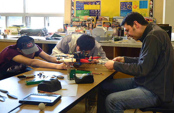 Professor Craig Steeves (UTIAS), right, assembles a quadrotor drone with Grade 10 students at Dennis Franklin Cromarty High School in Thunder Bay, Ont. (Photo: Rikky Duivenvoorden)