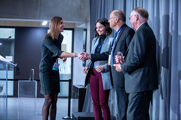 From left: Dr. Allison Brown presents EllisDon Sustainability Coordinator Kaitlyn Tyschenko, Senior Vice President of Construction Sciences George Charitou and Senior Vice President of Aligned Chris Andrews with the Corporate Academic Citizen Award. (Photo: Paul Terefenko)
