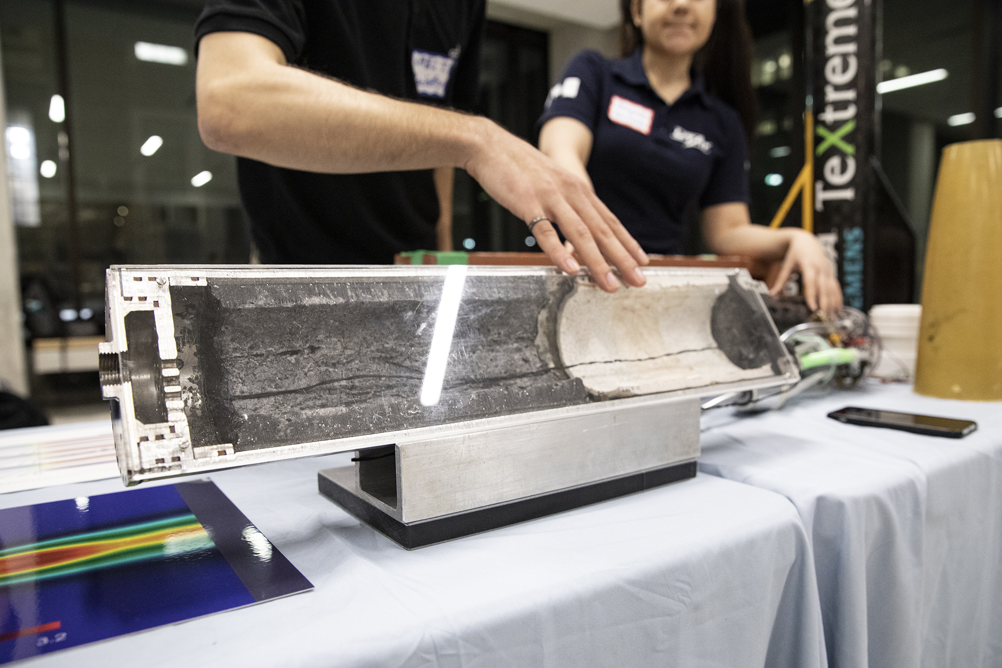 A cross-section of a hybrid engine fuel core lets students visualize the inside of a rocket. (Credit: Erica Rae Chong)