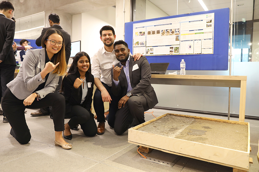Fourth-year students Flavia Ng (CivE), Sayuri Guruge (MSE), Tayyeb Zarabi (MechE) and Jonathan Jeyarajah (MechE) designed a flooring solution to reduce exposure to contaminated soil found in the households of Indigenous communities in Guatamala. (Photo credit: Liz Do)