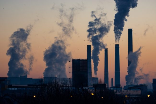 Emissions are seen rising from an industrial facility. Professor Greg Evans (ChemE) studies connections between air pollution and human health. (Photo: Ella Ivanescu / Unsplash)