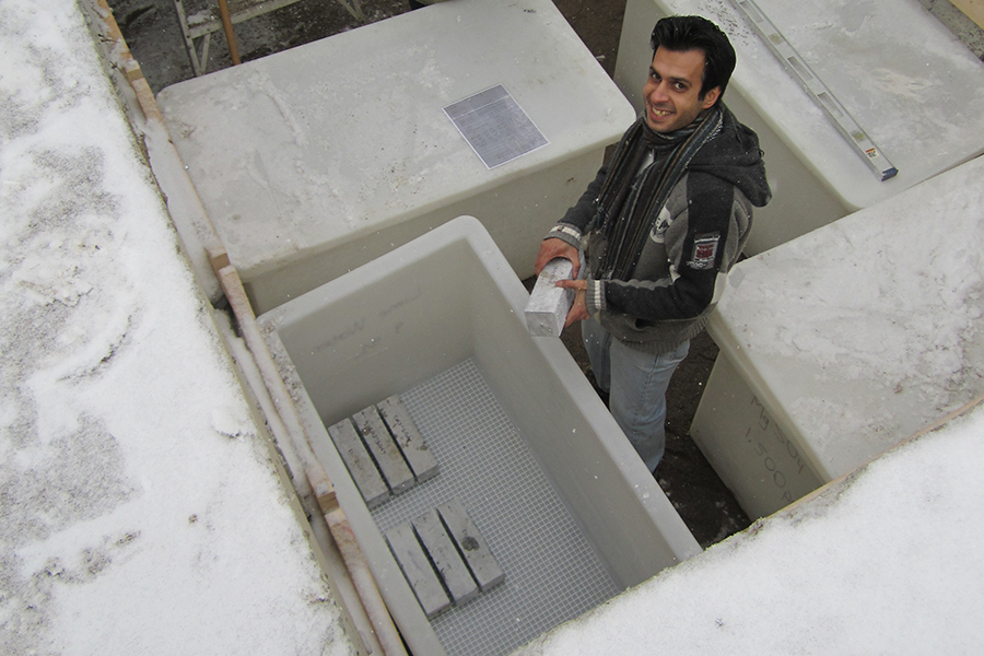 In this photo from 2010, then-graduate student Reza Ahani (CivMin PhD 1T9) prepares concrete samples made with various formulations for testing. (Photo Doug Hooton)