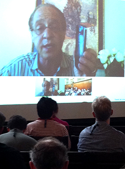Ray Kurzweill addresses the conference from California.