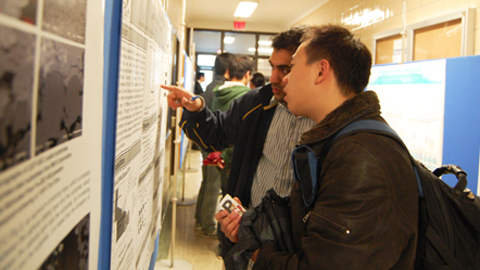 Students take the opportunity to learn more about energy research during the poster presentations portion