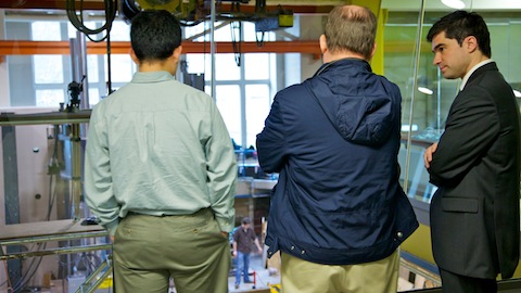 Michael Gray, at right, discusses his yielding brace system research