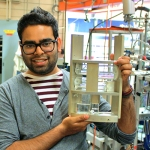 Post-doctoral fellow Aaron Persad (MIE) shows his experiment that aims to solve the longstanding mystery of how water behaves in space. (credit: Aaron Persaud).