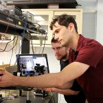 U of T doctoral researchers Iliya Sigal (right) and Dene Ringuette are part of a team that designed a miniature microscope that could open new doors for epilepsy and seizure monitoring and treatment. (Credit: Luke Ng).
