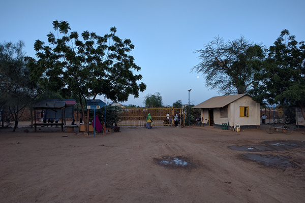 Dusk falls on the main gates to the health clinic in the Kakuma Refugee Camp in Kenya where the team worked each day. The researchers ran 600 tests for measles and rubella using their portable lab-on-a-chip technology. (Credit: Ryan Fobel)