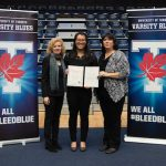 Nathalin Moy (pictured centre) accepts her U of T Engineering Varsity Blues Academic Excellence Award