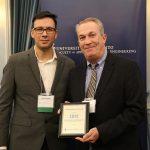 Professor David Sinton presents and award to IBM's Allen Lalonde