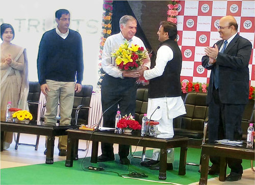 Ratan Tata (centre, with flowers) chairman of the Tata Trusts, with Akhilesh Yadav (centre, right), chief minister of Uttar Pradesh at the launch of the double-fortified salt distribution program (Photo: Micronutrient Initiative)