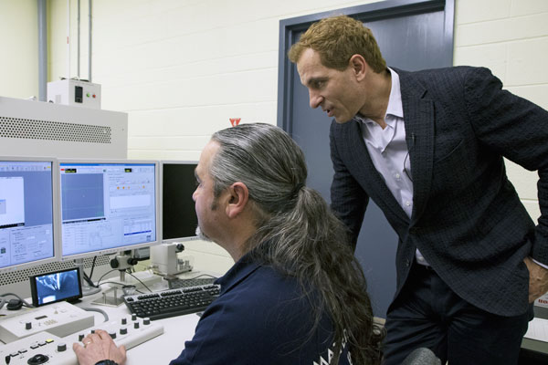 Professor Doug Perovic (right) and engineering technologist Sal Boccia look over images produced by a high-powered electron microscope. (Photo: Romi Levine)