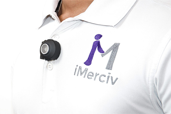 The BuzzClip device on a golf shirt