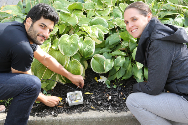 Mahmoud and Bilton demonstrate the soil moisture probe. In March, Spero Analytics began a pilot project involving 30 networked probes in Nepal. (Photo: Tyler Irving)