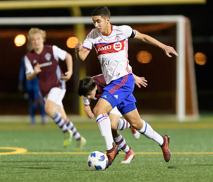 Mehdi Essoussi (ECE Year 1) shakes off a defender in a game against Colorado Rapids in Houston. (Courtesy: Mehdi Essoussi)