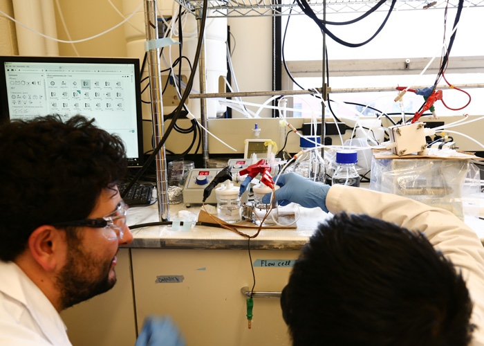 Pelayo and Dinh use their catalyst in an electrolyzer that splits water into hydrogen and oxygen. (Photo: Tyler Irving)